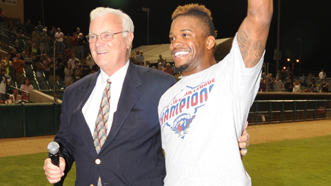 Delino DeShields gets the MVP trophy from Cal League president Charlie Blaney.